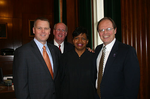 Associate Supreme Court Justice Cheri Beasley with PBA Representatves (L-R) NC PBA Division President Randy Byrd, PBA Attorney Mike McGuinness, Assoiciate Supreme Court Justice Cheri Beasley, and NC PBA Executive Director John Midgette
